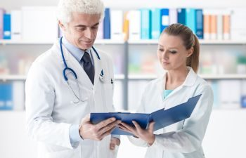 Doctors Reviewing Files